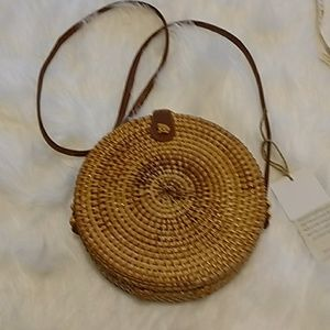 Round straw crossbody bag. Awesome!